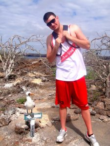 Matt in the Galapagos Islands, standing next to a Nazca Boobie, 2013